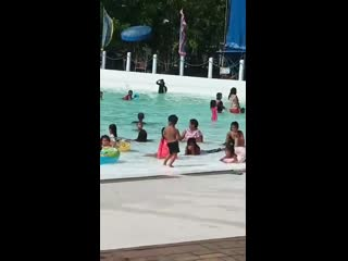 Little kid dancing at a waterpark