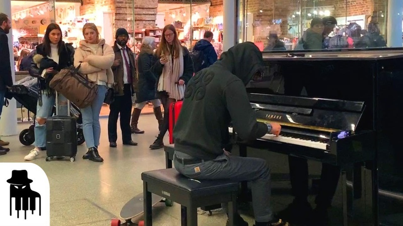 Skateboarder in hoodie amazes public with sublime piano music