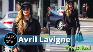 Avril Lavigne shares a smile while out with a girlfriend | Paps4Real