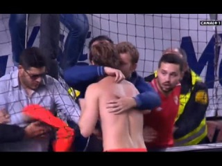 Ivan Rakitic strips down and hands his kit over to members of Sevilla's Biris