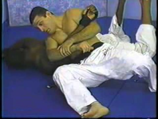 Ralph Gracie tutorial-2 - Defense Against Punches, Knees, Head-butts & Headlocks