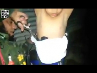 Iraqi soldier removes suicide belt from boy in mosul