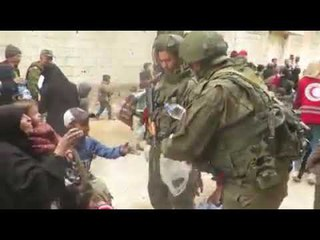 SYRIA:RUSSIAN SOLDIERS HELPING CHILDREN OF EASTERN GHOUTA DAMASCUS