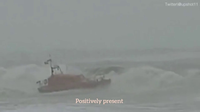 Coastguard boat almost capsizes while rescuing surfer in storm