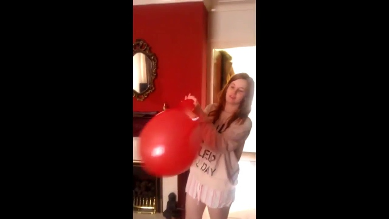 (97) Scared girl blows up huge red balloon at home including accidental pop