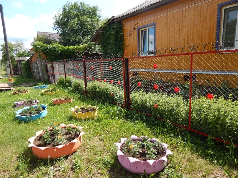 Изгородь у дома Козыревых.