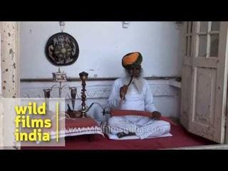 Rajasthani man smokes hookah the traditional way